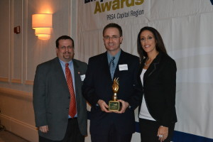 Photo of Edward Parham, Rueckert Advertising and Public Relations, receiving Outstanding Practitioner  Award at the 6th Annual PRSA Capital Region Empire Awards.